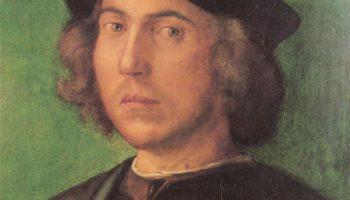 Портрет молодого человека на зелёном фоне